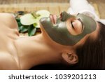spa clay mask. woman with clay... | Shutterstock . vector #1039201213