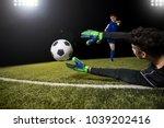 football player kick ball and... | Shutterstock . vector #1039202416
