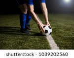 cropped shot of footballer... | Shutterstock . vector #1039202560