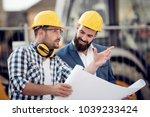 two engineer builders with plan ... | Shutterstock . vector #1039233424