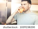 handsome young man drinking... | Shutterstock . vector #1039238200