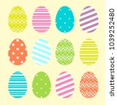 colorful easter eggs set in... | Shutterstock .eps vector #1039252480