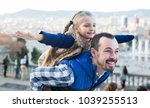 smiling father and daughter... | Shutterstock . vector #1039255513