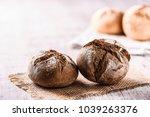 dark tasty rolls bread on white ...   Shutterstock . vector #1039263376