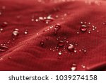 rain water droplets on  red... | Shutterstock . vector #1039274158