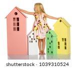 a cute little girl is playing... | Shutterstock . vector #1039310524