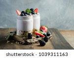 yogurt and granola with berries ... | Shutterstock . vector #1039311163