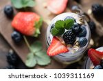 yogurt and granola with berries ... | Shutterstock . vector #1039311169