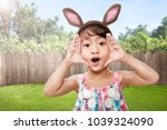 happy asian little child with... | Shutterstock . vector #1039324090