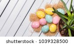colorful easter eggs on white...   Shutterstock . vector #1039328500