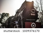 parked vintage train parked in ... | Shutterstock . vector #1039376170