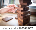 hand of man planning  risk and... | Shutterstock . vector #1039415476