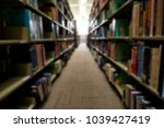 blurred books in library... | Shutterstock . vector #1039427419
