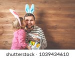 father and daughter in bunny... | Shutterstock . vector #1039434610