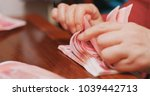 counting the number of rmb by... | Shutterstock . vector #1039442713