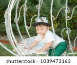 thai boy with the hat in the... | Shutterstock . vector #1039473163