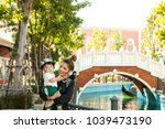 the boy and momy with the... | Shutterstock . vector #1039473190