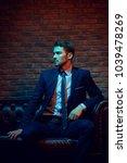 respectable handsome man in... | Shutterstock . vector #1039478269