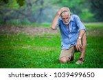 despair senior man put hand on... | Shutterstock . vector #1039499650