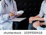 patient listening intently to a ... | Shutterstock . vector #1039500418