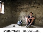 a fit young caucasian man takes ... | Shutterstock . vector #1039520638