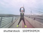 urban jogger stretching on a... | Shutterstock . vector #1039543924