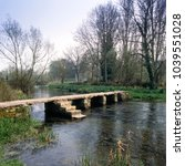 Small photo of England, Cotswolds, Gloucestershire, Eastleach, River Leach, ancient clapper bridge