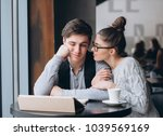guy and girl at a business... | Shutterstock . vector #1039569169