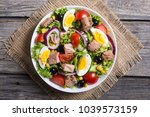 tuna salad with tomatoes  ... | Shutterstock . vector #1039573159