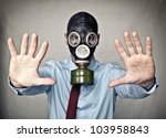 Businessman With Gas Mask Stop...