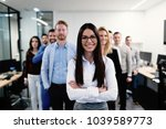 successful team of young... | Shutterstock . vector #1039589773
