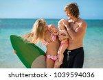 family having fun surfing... | Shutterstock . vector #1039594036