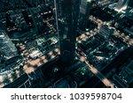 skyline city in the night | Shutterstock . vector #1039598704
