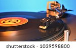 vinyl record on vintage... | Shutterstock . vector #1039598800