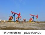 the oil pump  | Shutterstock . vector #1039600420