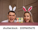 funny couple with bunny ears... | Shutterstock . vector #1039605670