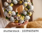 girl holding spring wreath with ... | Shutterstock . vector #1039605694