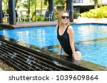young female relax in swimming... | Shutterstock . vector #1039609864