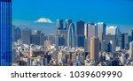 tokyo skyline with mount fuji   ... | Shutterstock . vector #1039609990