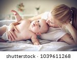 spending time with mommy.... | Shutterstock . vector #1039611268