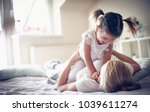 mother have playing at morning... | Shutterstock . vector #1039611274