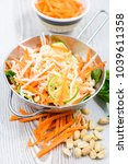 vietnamese carrot salad on... | Shutterstock . vector #1039611358