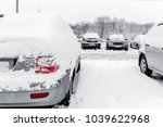 cars in snow in winter after...   Shutterstock . vector #1039622968