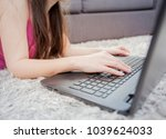 female using laptop at home | Shutterstock . vector #1039624033