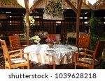 restaurant table for four... | Shutterstock . vector #1039628218