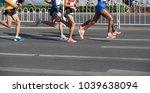 legs of marathon runners... | Shutterstock . vector #1039638094