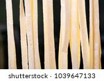 fresh handmade pasta drying on... | Shutterstock . vector #1039647133