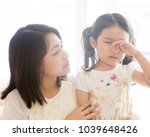 mother comforting crying... | Shutterstock . vector #1039648426
