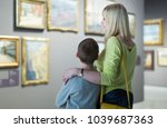 positive germany  mother and... | Shutterstock . vector #1039687363