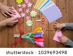 parent and child hand playing... | Shutterstock . vector #1039693498